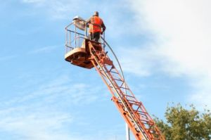 electrician on the bucket ladder